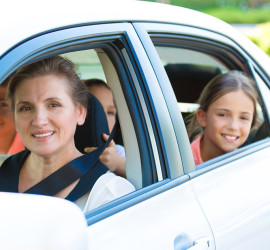 woman and girls in car